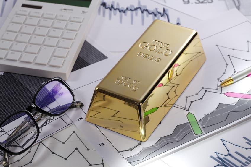 Comportamiento del oro - Lingote de oro sobre gráficos