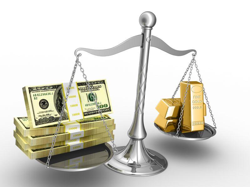 Balanza con dolares y oro