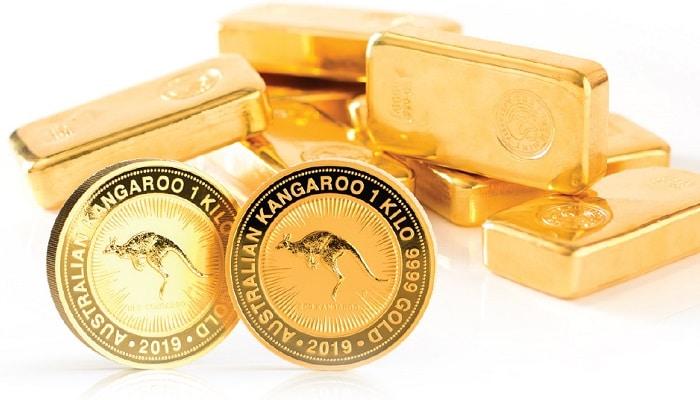 Monedas de oro y lingotes de oro